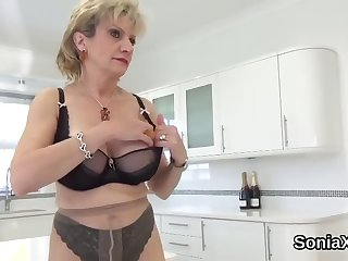 unfaithful english mature lady sonia flashes her massive tits