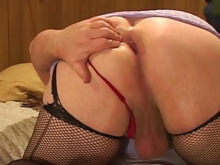 Drilling his ass with toys wearing female nylon stockings